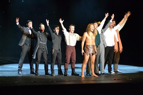 Ryan Garmoe (wearing suspenders) sings in a medley with other Best Actor nominees at the Dallas Summer Musicals Awards Show